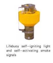 Lifebuoy self-igniting light and self-activating smoke signals